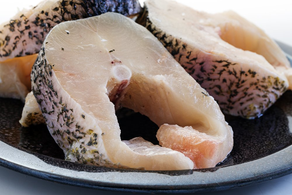 raw northern pike steaks, fresh fish prepared for grilling or frying
