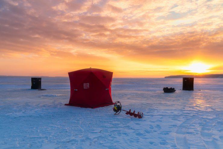 ice fishing shelter on the lake