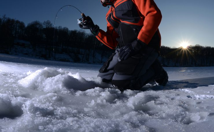 ice fishing with fish on the line