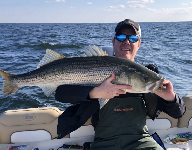 Brian Nagele holding a striped bass