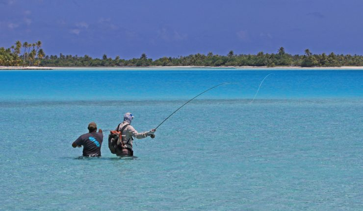 Man saltwater Flyfishing With A Guide