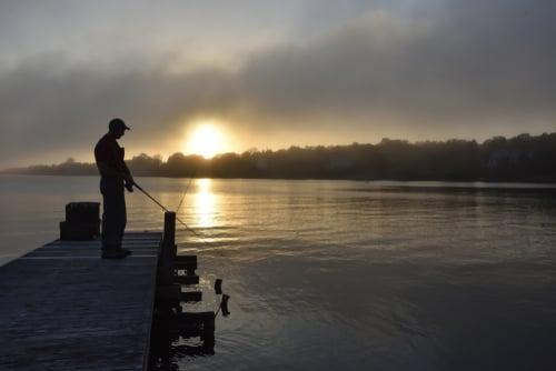 man fishing on lake erie near buffalo ny