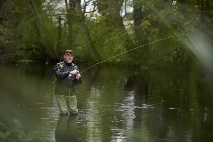 man fly fishing in a river in northumberland county pa