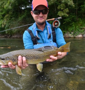 fisherman catching a brown trout