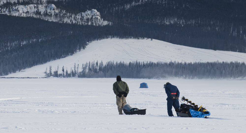 dragging ice fishing sled with gear