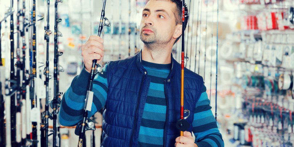 Man Choosing a fishing rod