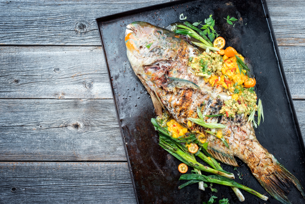 Traditional BBQ parrotfish with mango salsa
