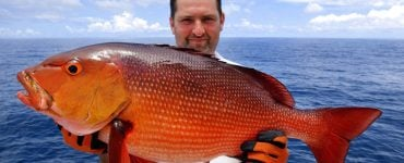 florida fisherman holding a snapper